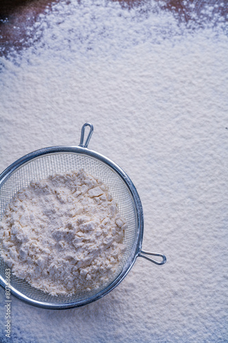 sieve with flour copyspace food and drink concept