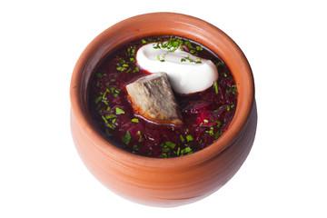borscht with sour cream in a pot
