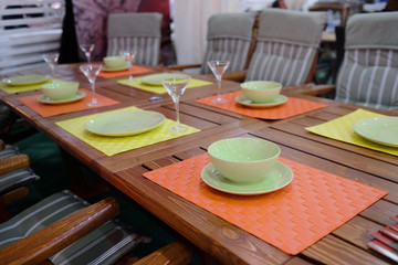 Empty bowls, plates and glasses on the dining table