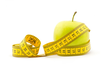 Healthy lifestyle concept. Green apple with measuring tape