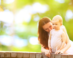 young mother and baby outdoor