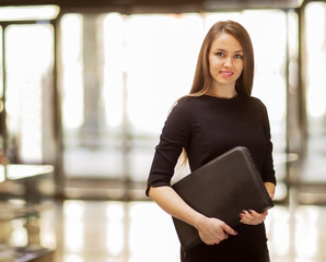 young business woman smiling in the office