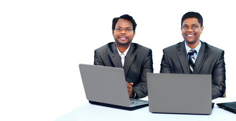 Interracial business team working at laptop
