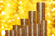 Golden goins stack with golden lights bokeh background