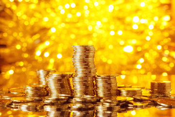 Golden goins stack with golden lights background