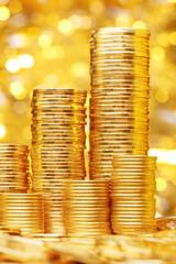 Sparkling new golden coins stacks