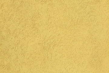 Yellow stucco wall. Background texture.