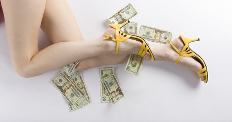 Sexy Woman Legs on the Floor with US Dollars