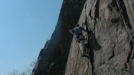 Rock climber on granite wall