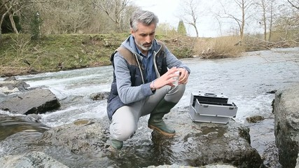 Biologist testing quality of natural water