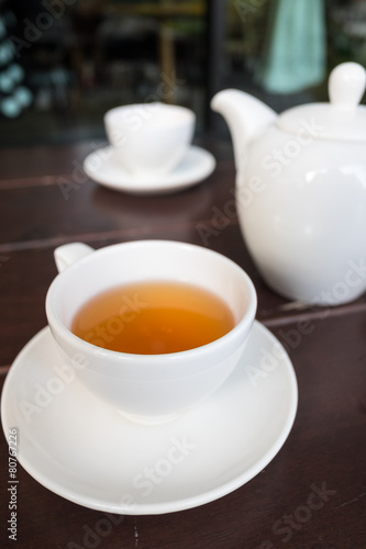 Foto op Aluminium Thee White porcelain teacup and saucer with teapot