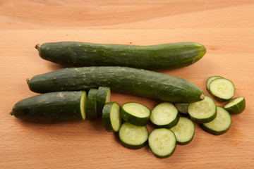 Cucumbers on wooden table