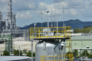 Chemical plant with equipment vessel cylinder.