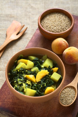 Bowl of spinach, peach and potato curry dish