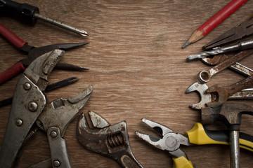 Old tools renovation on grunge wood.