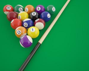 Billiard balls with cue on a green billiard table