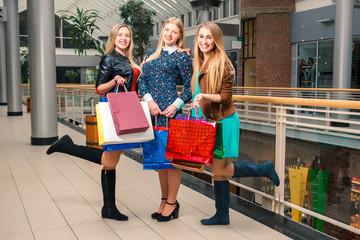three beautiful girls with shopping bags