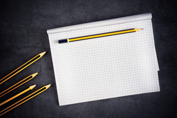 Pencils And Blank Notepad Page