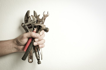 Hand of male holding old tools renovation on white background.