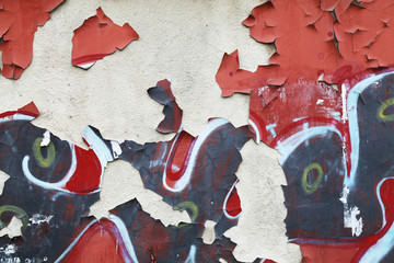 Grungy wall background texture with graffiti fragments