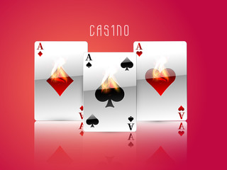 Ace playing cards in fire for casino on red background.