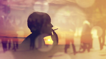 Silhouette of a Woman Smoking Cigarette in Sunset