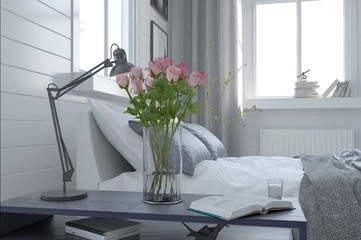 Pretty vase of fresh pink roses in a bedroom