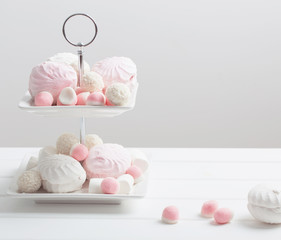 marshmallows and fruit jelly on white