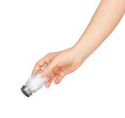 hand holding a glass salt shaker on white background