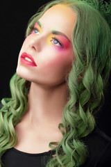 Imagination. Woman with Dyed hair and Fancy Creative Makeup