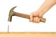 Leinwanddruck Bild - Hammer and Nail Using hammer and nail on wood