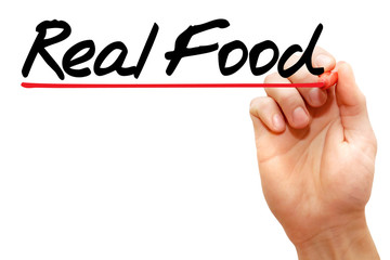 Hand writing Real Food with marker, health concept