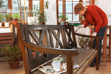 Painting an outdoor bench