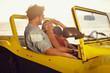 Leinwanddruck Bild - Romantic young couple in a car