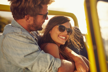 Loving young couple enjoying themselves on a road trip