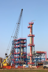 new refinery construction site with machinery