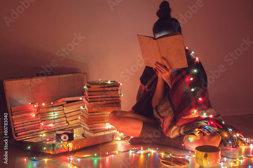 Well-read girl at home. Night exciting reading - 80783040