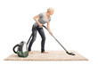 Woman vacuuming a carpet with vacuum cleaner