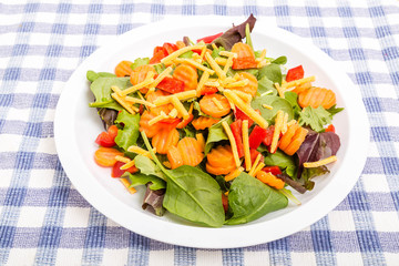 Spinach Salad with Carrots Peppers and Cheese
