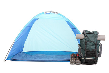 Blue tent, a rucksack and pair of boots on white