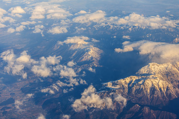 View of a massif from a window of the flying plane