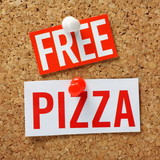 Free Pizza incentive message on a cork notice board poster