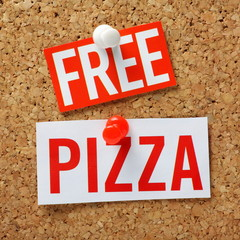 Free Pizza incentive message on a cork notice board