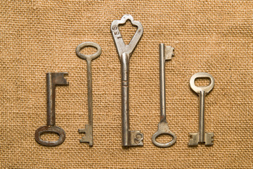 Four old keys to the safe on a very old cloth
