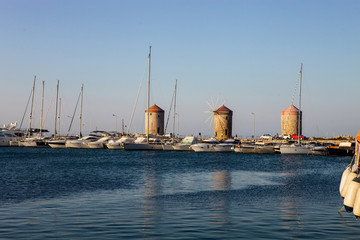 entrance to the harbor of Rhodes, Greece, behind  three towers