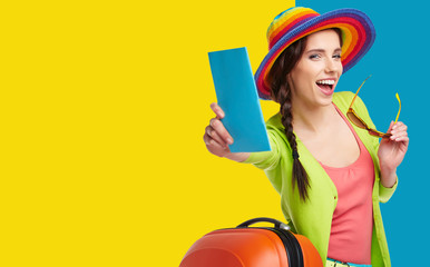 Woman tourist with travel suitcase and blue boarding pass,