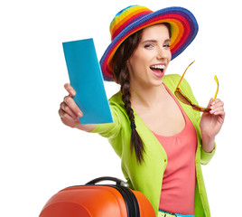 Portrait of female tourist with travel suitcase and blue boardin