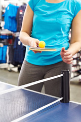 Woman with table tennis racquet