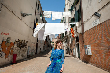 Happy girl walking in Venice, Italy