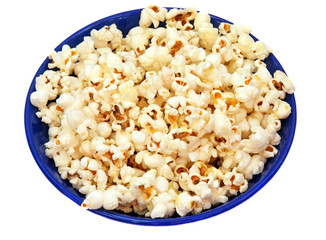 Popcorn in a blue plate isolated closeup